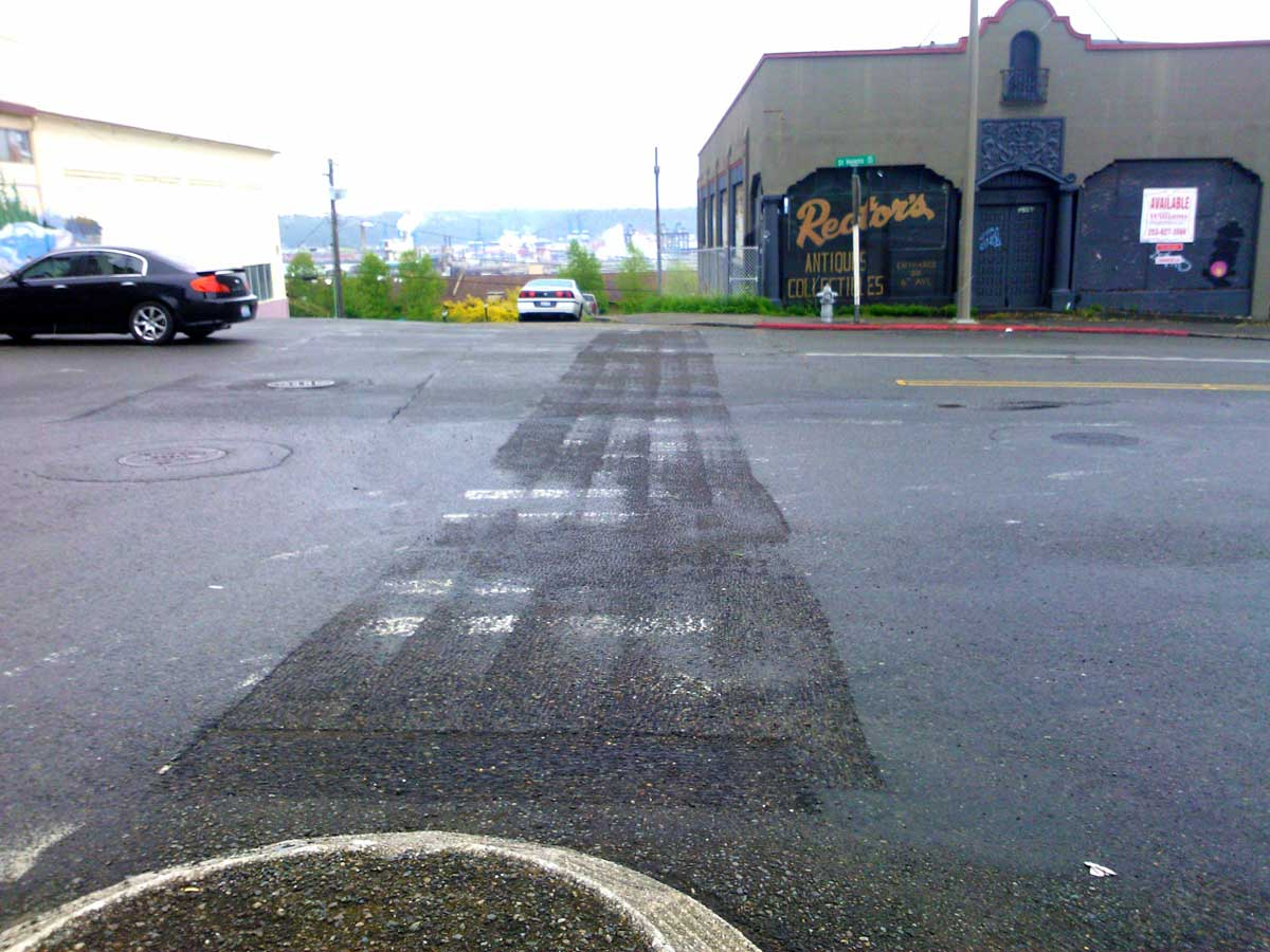 City of Tacoma crews removed unauthorized crosswalk markings at 6th & St Helens.